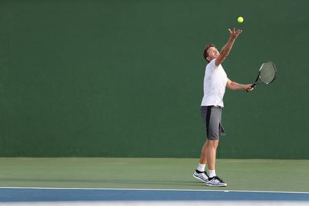 Tennis serve player man serving ball during match point on outdoor green court. Standard-Bild