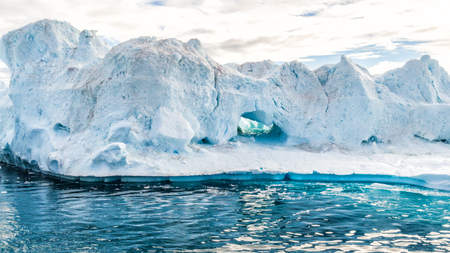 Climate Change and Global Warming - Icebergs from melting glacier in icefjord in Ilulissat, Greenland. Aerial video of arctic nature ice landscape.