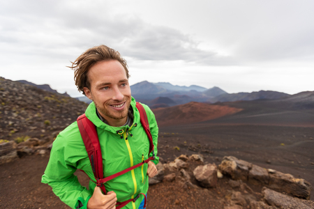 Mountaineer hiker man walking on mountain trail hike in Maui Haleakala crater volcano, Hawaii USA travel lifestyle. Stock Photo