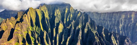 Hawaii travel aerial background of Na Pali coast, Kauai, Hawaii helicopter view. Nature coastline landscape in Kauai island, Hawaii, USA. Panoramic banner crop. Stock Photo