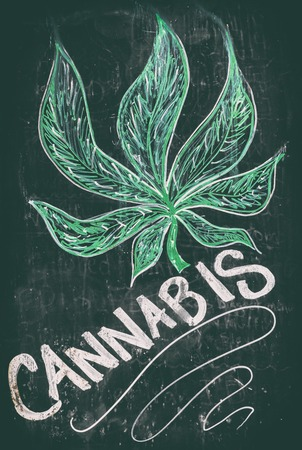 Cannabis drawing on chalkboard blackboard sign of dispensary - Marijuana legalization in Canada on October 17, 2018. It is now legal to smoke and buy weed, pot, THC, in shops nationwide. Stock Photo