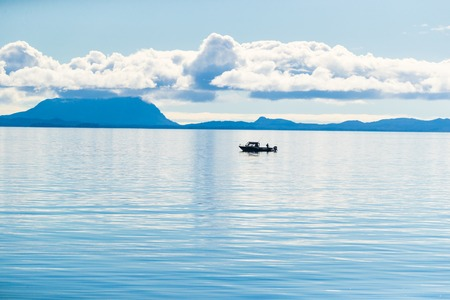 Alaska scenery tranquil scene in the morning - fisherman boat on Arctic sea in Ketchikan, USA travel in summer.