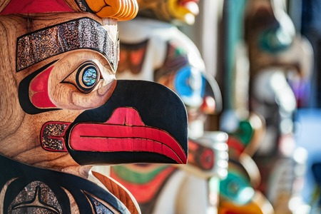 Alaska totem pole carving art sculture store in tourist travel attraction town on Alaska cruise. Ketchikan, Juneau, Skagway stores and shops selling native paintings and art. Closeup of an Eagle.