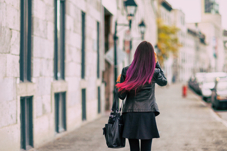 Colored hair style woman walking from behind with long brown ombre dyed hair. Fashion urban young people hair salon coloring dyeing treatment. 版權商用圖片