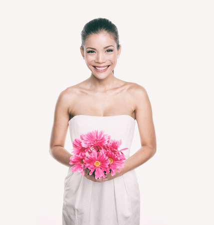Bridesmaid wedding dress girl with flower bouquet. Asian woman beauty in studio. Maid of honor or bride getting married. Stock Photo