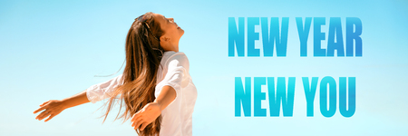 New Year New Start happy woman with open arms in freedom and carefree banner panorama. Girl healthy, well-being concept on blue background. Banque d'images
