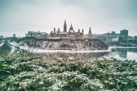 Ottawa Parliament in Winter . Cityscape of Canadas capital city, canadian travel destination in snow landscape.