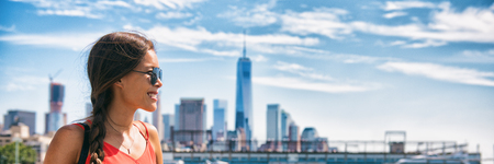 New York city woman tourist at One World Trade center skyline summer vacation USA travel lifestyle. Tourism in the USA. NYC banner panorama background. Stock Photo