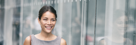 Asian business woman smiling portrait walking in office going to work. Career lifestyle young professional businesswoman happy. Panoramic banner. Stock Photo