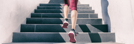 Active weight loss training workout running up stairs for hiit workout cardio training. Staircase climbing run woman going run up steps panorama banner. Runner athlete doing sport workout. Stock Photo