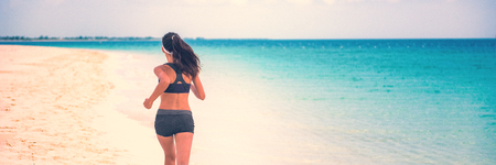 Healthy active people lifestyle banner - Woman runner running on beach summer run background panorama.