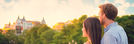 Couple together relaxing watching sunset outside on Europe summer holidays banner panorama .Background header with two young people in love happy.