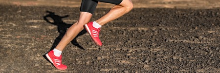 Sport and fitness run background panoramic banner. Runner man trail running shoes crop.