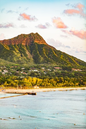 Hawaii travel Honolulu city vacation destination. Waikiki beach with Diamond Head mountain in background. Urban landscape for USA travel summer getaway.