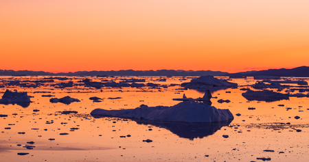 Global Warming and Climate Change - Icebergs from melting glacier in icefjord in Ilulissat, Greenland. Aerial image of arctic nature iceberg and ice landscape. 写真素材
