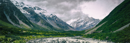 Hooker Valley Track hiking trail, New Zealand. View of Aoraki Mount Cook National Park with snow capped mountains. Banner panorama landscape. Stock Photo - 115457796