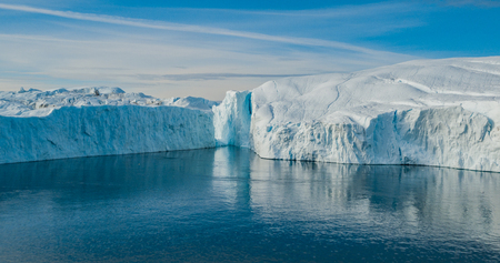Iceberg aerial photo - giant icebergs in Disko Bay on greenland floating in Ilulissat icefjord from melting glacier Sermeq Kujalleq Glacier, aka Jakobhavns Glacier. Global warming and climate change