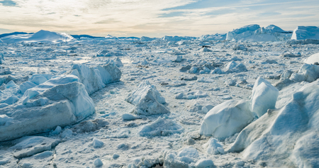 Global Warming and Climate Change - Icebergs from melting glacier in icefjord in Ilulissat, Greenland. Aerial image of arctic nature iceberg and ice landscape. Stock Photo