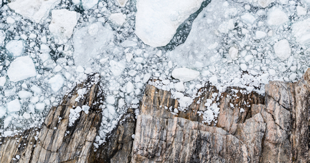 Climate Change and Global Warming - Icebergs drone aerial image top view. Icebergs from melting glacier in icefjord in Ilulissat, Greenland. Stock Photo