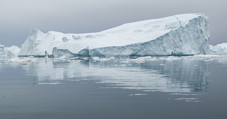 Climate Change and Global Warming - Icebergs from melting glacier in icefjord in Ilulissat, Greenland. Image of arctic nature ice landscape. Stock Photo