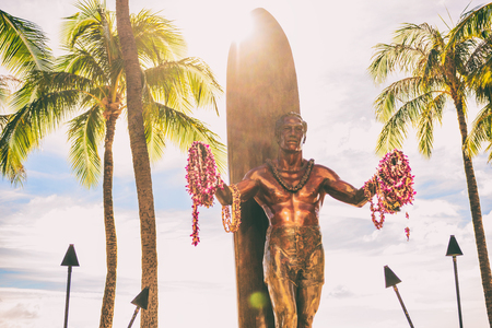 Waikiki Beach Honolulu, statue of Duke Kahanamoku. Travel on Oahu, Hawaii. Famous tourist attraction and surfing landmark in the USA. Sunshine.