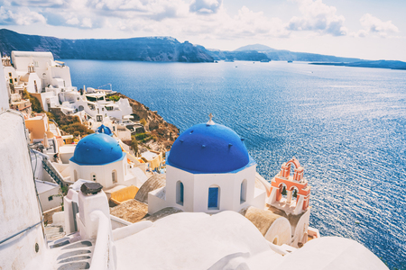 Santorini Greece Europe luxury travel vacation getaway. Famous tourist attraction Three Blue Domes church view in Oia village. European destination greek island.