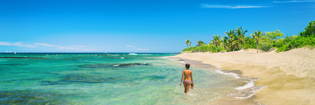 Hawaii beach woman relaxing swimming in bikini in idyllic ocean of lost paradise remote island tropical getaway. Wanderlust and adventure lifestyle banner panorama.
