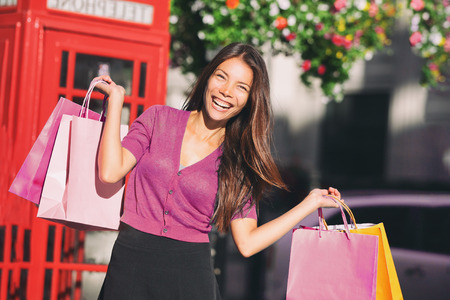 Shopping bags Asian woman in London shops spending money - Europe travel tourist chinese girl having fun enjoying summer holidays. Stock Photo