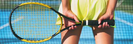 Tennis racket playing woman. Tennis court background girl from behind in fashion skirt sportswear. Sport player blue hard court banner panorama.