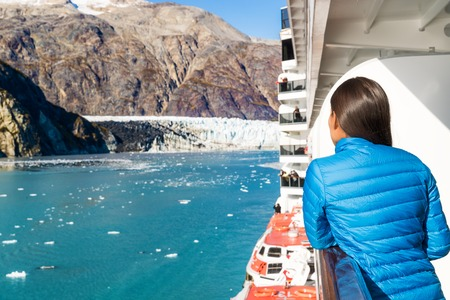 Travel tourist on cruise ship in Glacier Bay, Alaska, USA. Amazing view of glacier landscape on clear blue sky day in summer. Stock Photo