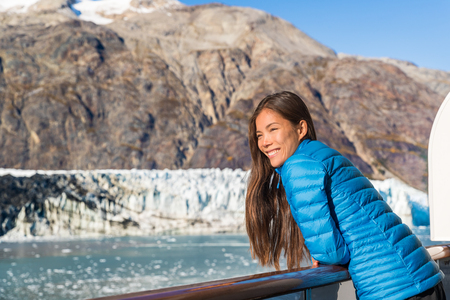 Alaska cruise ship tourist looking at glacier front in Glacier Bay National Park, USA. Woman on travel vacation sailing enjoying view of Margerie Glacier. Stock Photo - 117685265
