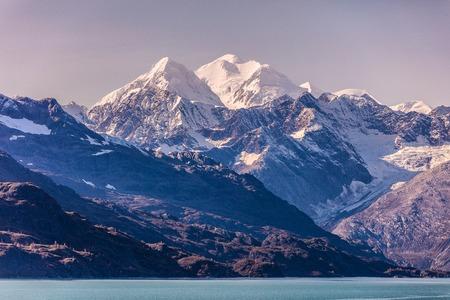 Alaska nature Mountains landscape in Glacier Bay at dusk, purple sky, Alaska, United States, USA cruise travel destination.