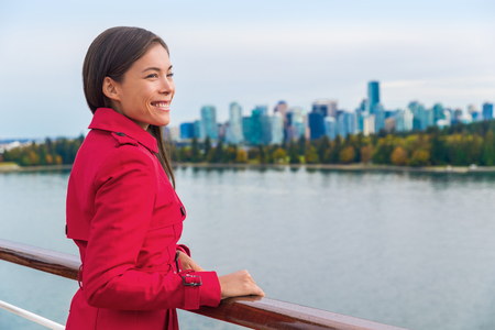 Cruise passenger enjoying view leaving Vancouver city on Alaska cruise travel. Asian woman on deck of cruise ship, British Columbia, Canada.