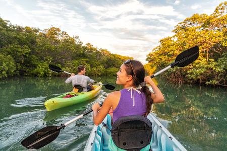 Couple kayaking together in mangrove river of the Keys, Florida, USA. Tourists kayakers touring the river of Islamorada. Stock fotó - 117685351