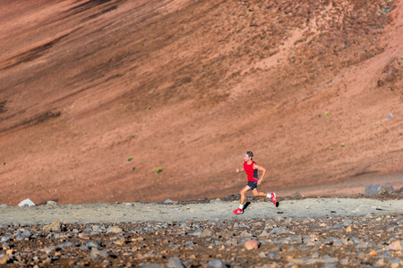 Man trail running in the mountain Stock Photo