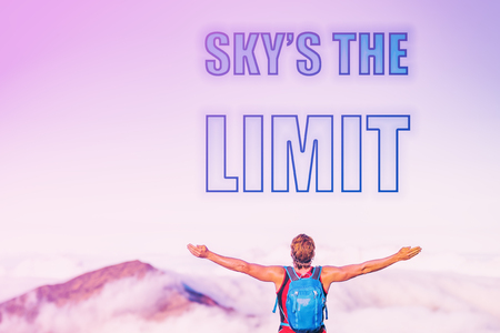 SKYS THE LIMIT sentence written on pink sky with clouds at sunset copy space. Man with open arms inspirational picture for motivational quote for life challenge for success. Reach your goals.