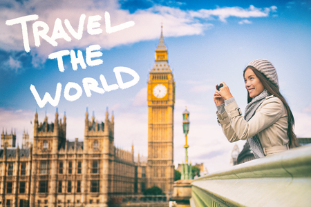 London europe background with TRAVEL THE WORLD inspirational quote written with paint. Travel woman taking pictures with phone, motivational concept. Tourist people taking photos traveling.
