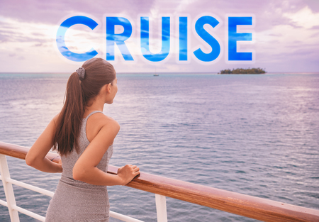 Cruise ship luxury travel people lifestyle. Word CRUISE in big letters written on background for tourism concept. Travel motivational quote adventure tourist on boat trip vacation in French Polynesia. 版權商用圖片