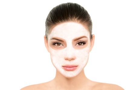 White facial treatment mud mask Asian beauty woman. Wellness and spa purifying cream for clean and smooth skin, isolated on white background. Cleansing skincare to moisturize, anti aging concept. 写真素材 - 117964252