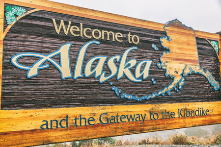 Alaska sign welcome billboad on the South Klondike Highway near Skagway.