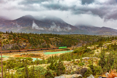 Alaska cruise excursion in Skagway - White pass and Yukon Railway train - scenic drive through nature landscape.