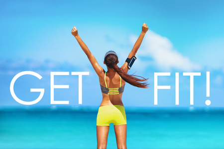 Get FIT motivational message weight loss poster for fitness concept. New Year resolution inspirational quote on beach background. Cheering winner woman with arms up training goal getting in shape. 版權商用圖片 - 118141249