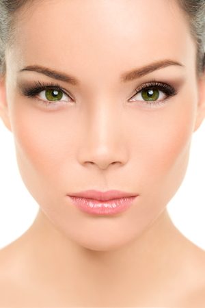 Asian beauty woman. Serious portrait of beautiful mixed race chinese with makeup smokey eyes eyeshadow, mascara, rouge blush on cheeks and lips. Plastic surgery, nose job, facelift. Stock Photo