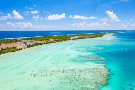 Drone video of French Polynesia Tahiti Fakarava atoll and famous Blue Lagoon and motu island with perfect beach, coral reef and Pacific Ocean. Aerial Tropical travel paradise in Tuamotus Islands. 스톡 콘텐츠