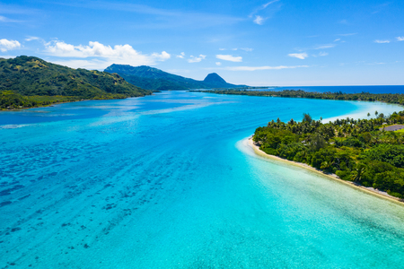 Aerial drone view of French Polynesia Tahiti island Huahine and Motu coral reef lagoon and Pacific Ocean. Tropical paradise. Stock Photo