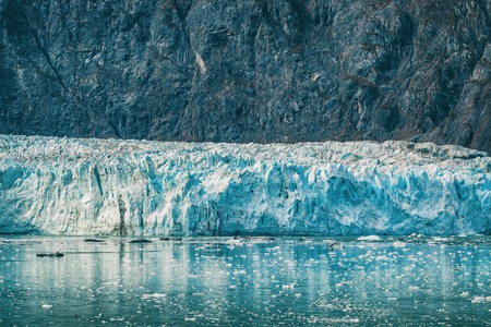 Alaska Glacier Bay landscape view from cruise ship holiday travel. Global warming and climate change concept with melting glacier with Johns Hopkins Glacier and Mount Fairweather Range mountains. Stock Photo