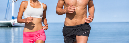 Couple athletes runners running on beach. Fitness people training cardio living an active and healthy lifestyle. beach background copy space. Banner panorama body crop.
