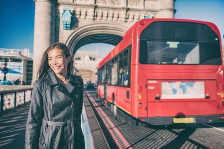 London travet tourist walking on Tower bridge street by red british bus on famous tourism attraction Europe summer vacation destination.