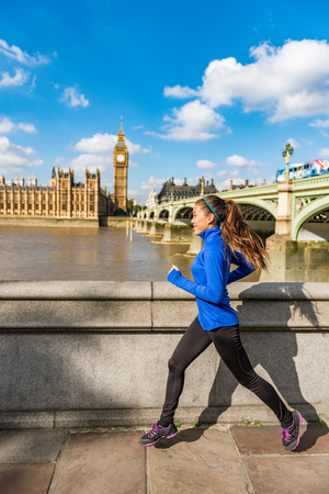 London running woman training for marathon. Sport girl jogging in city near Big Ben and Westminster bridge, exercising on the way to work. Morning workout to the office.