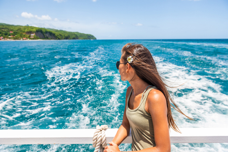 Cruise travel vacation woman relaxing by the water looking at Caribbean sea. St Lucia tourist girl enjoying tropical holidays.